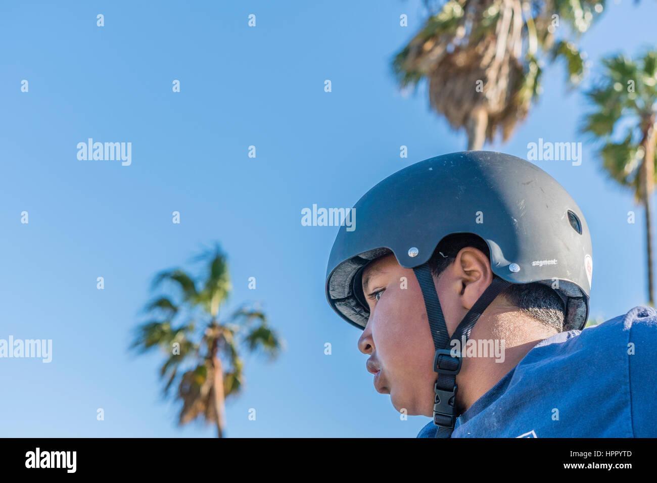 Young BMX riding boy wearing helmet. - Stock Image
