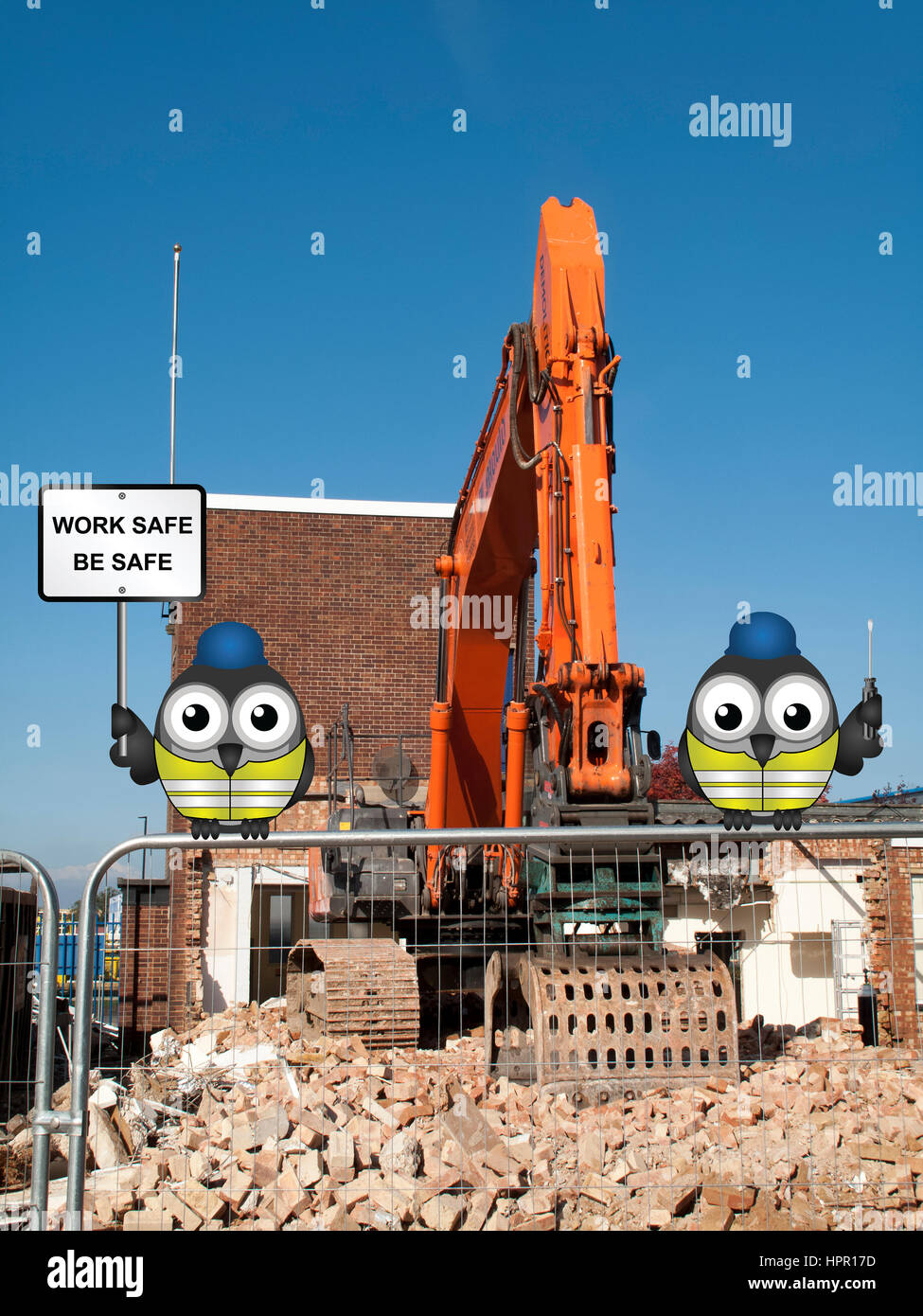 J mould Demolition Company based in Reading Berkshire, demolition of building with work safe message Stock Photo