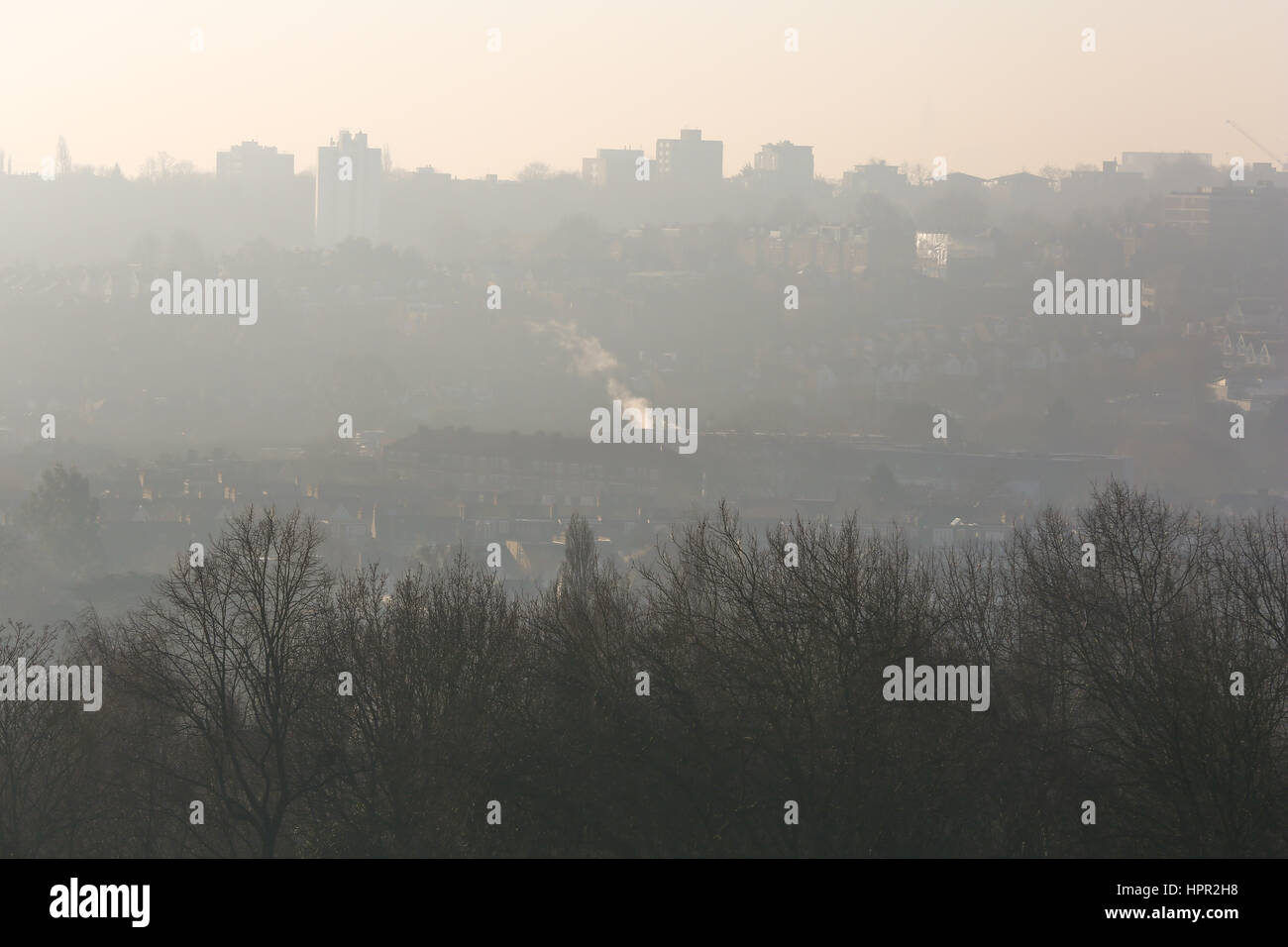 Heavy pollution can be seen cast over London from Alexandra Palace. A toxic air alert has been issued for London - Stock Image