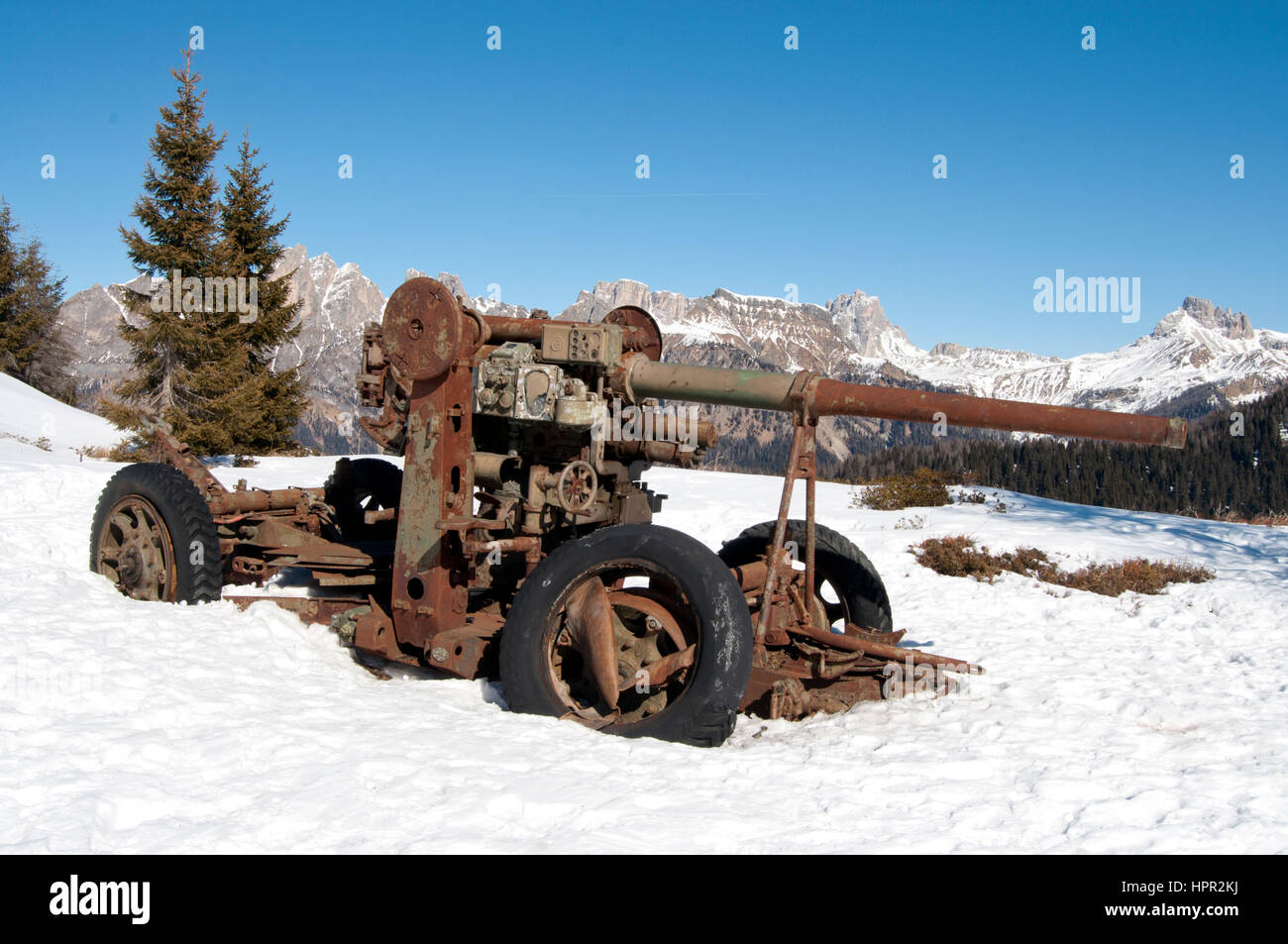 Cannon of the First World War abandoned on the war zone over the Dolomites, near Alleghe (Italy) - Stock Image