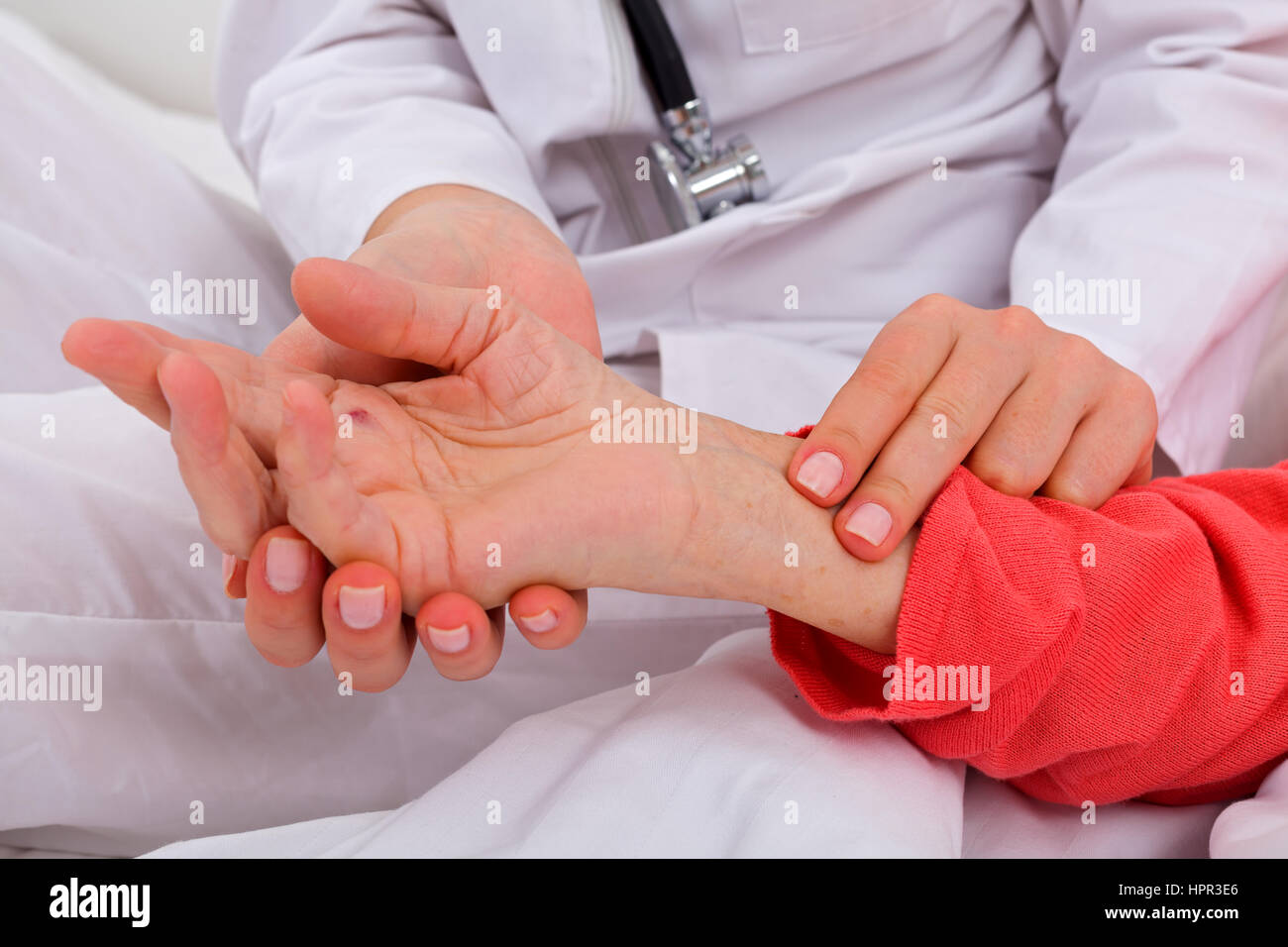 Caregiver checking patients blood pressure - Stock Image