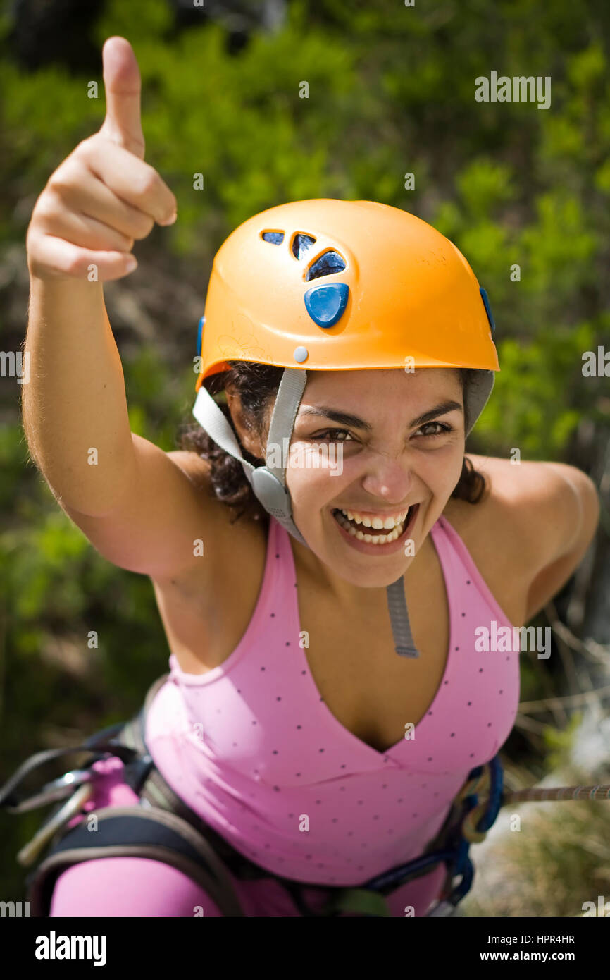 Woman with the hand up happy by the sucess rapel - Stock Image