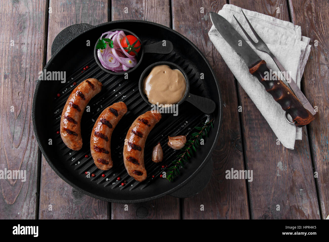 homemade grilled sausage with spices on grill - Stock Image