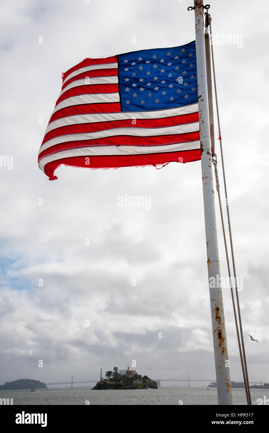 Flag fluttering from back of ferry boat in San Francisco Bay, California - Stock Image