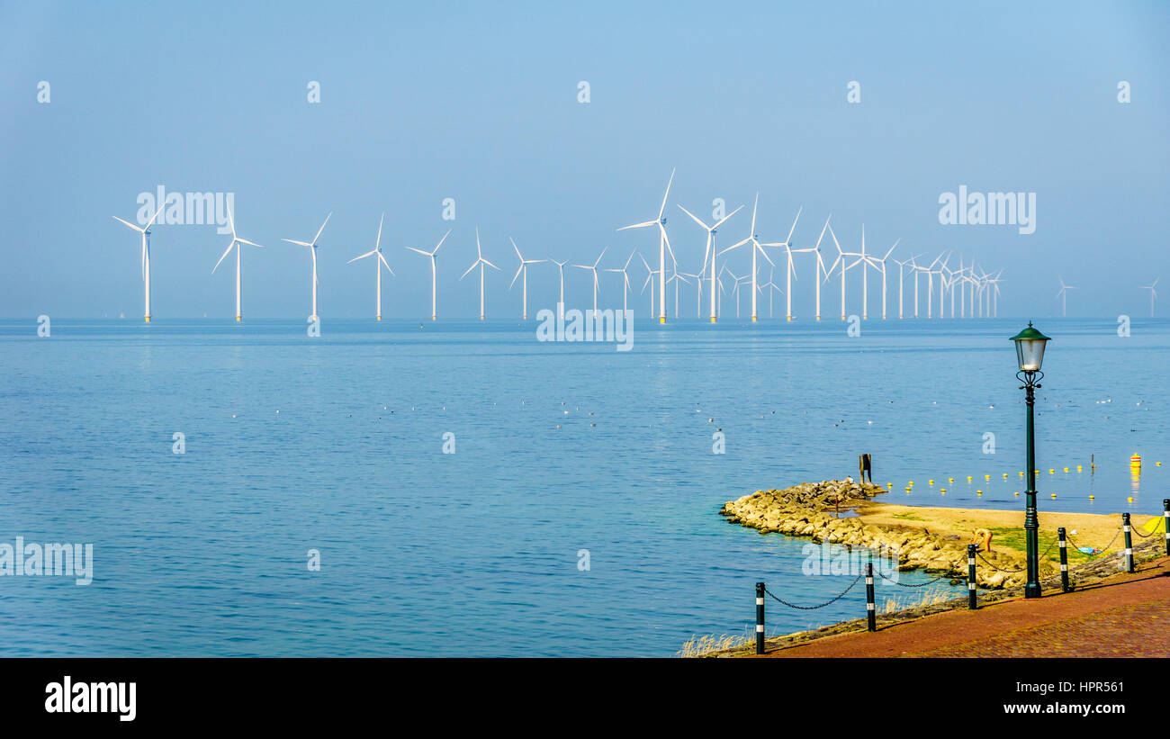 Wind Farm along the Shore of the IJselmeer at the historic fishing village of Urk in the Netherlands - Stock Image
