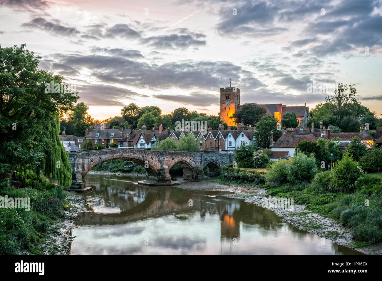 Aylesford, United Kingdom - June 6, 2015: Evening view of Aylesford village with medeival bridge across river Medway - Stock Image