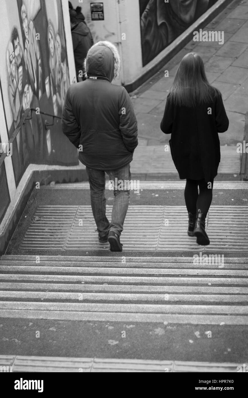 street photography two people walking to there destination - Stock Image