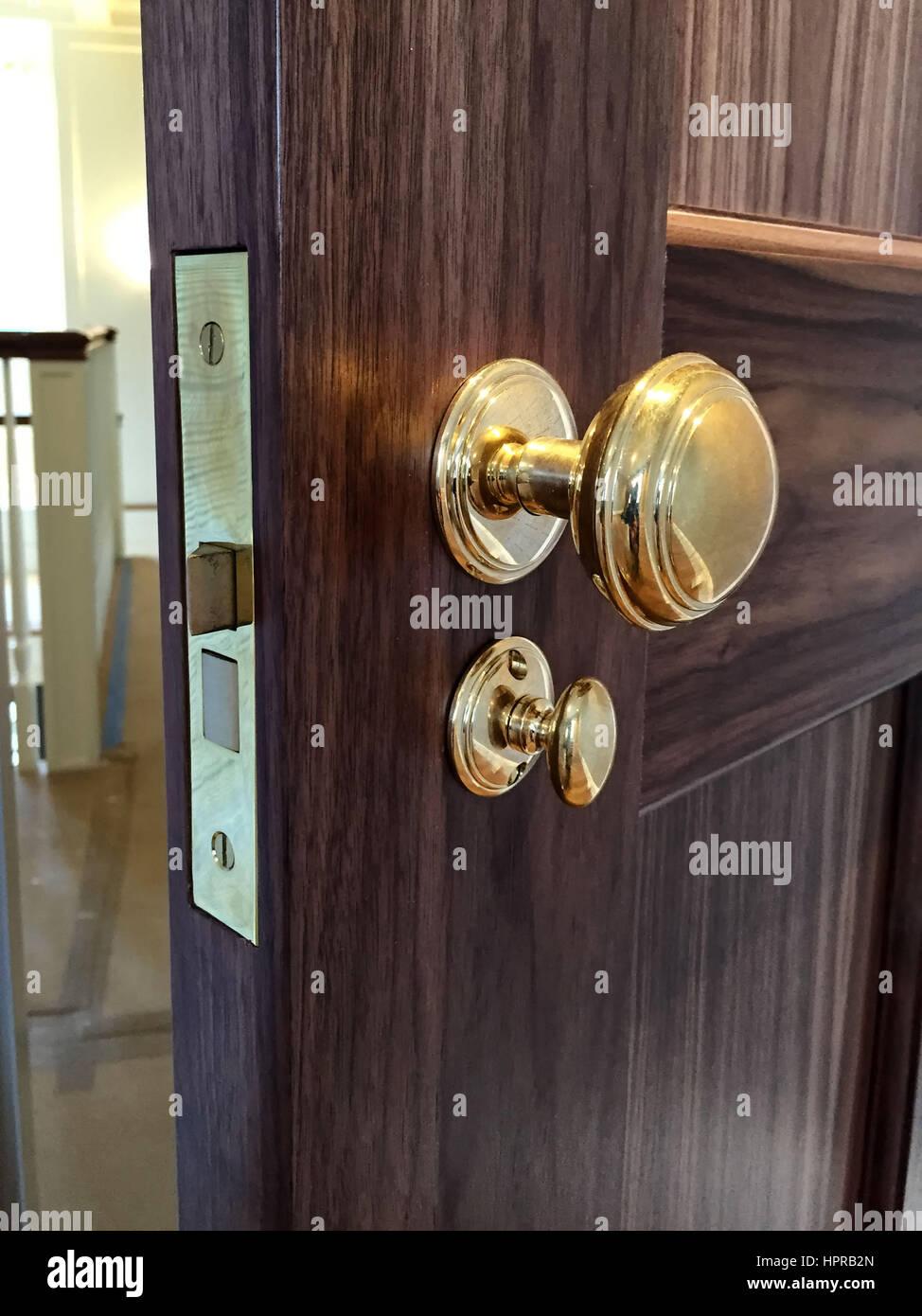 Brass Doorknob On Dark Wood Door