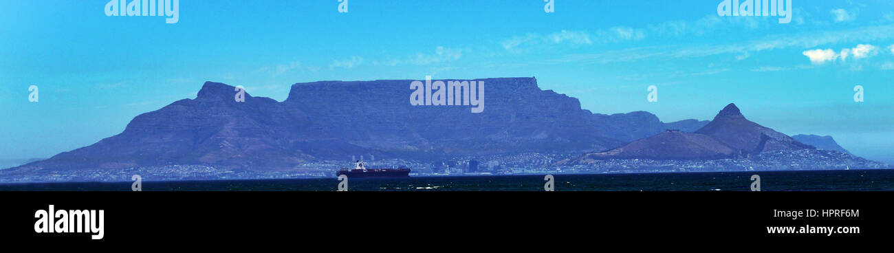 A panoramic view of Table mountain with the Lion's head peak and Signal hill on the right and Devil's peak - Stock Image