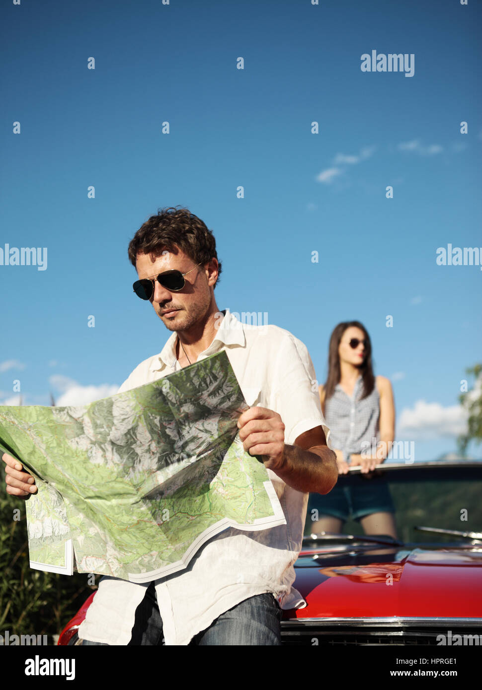 Beautiful couple trying to find their way Stock Photo