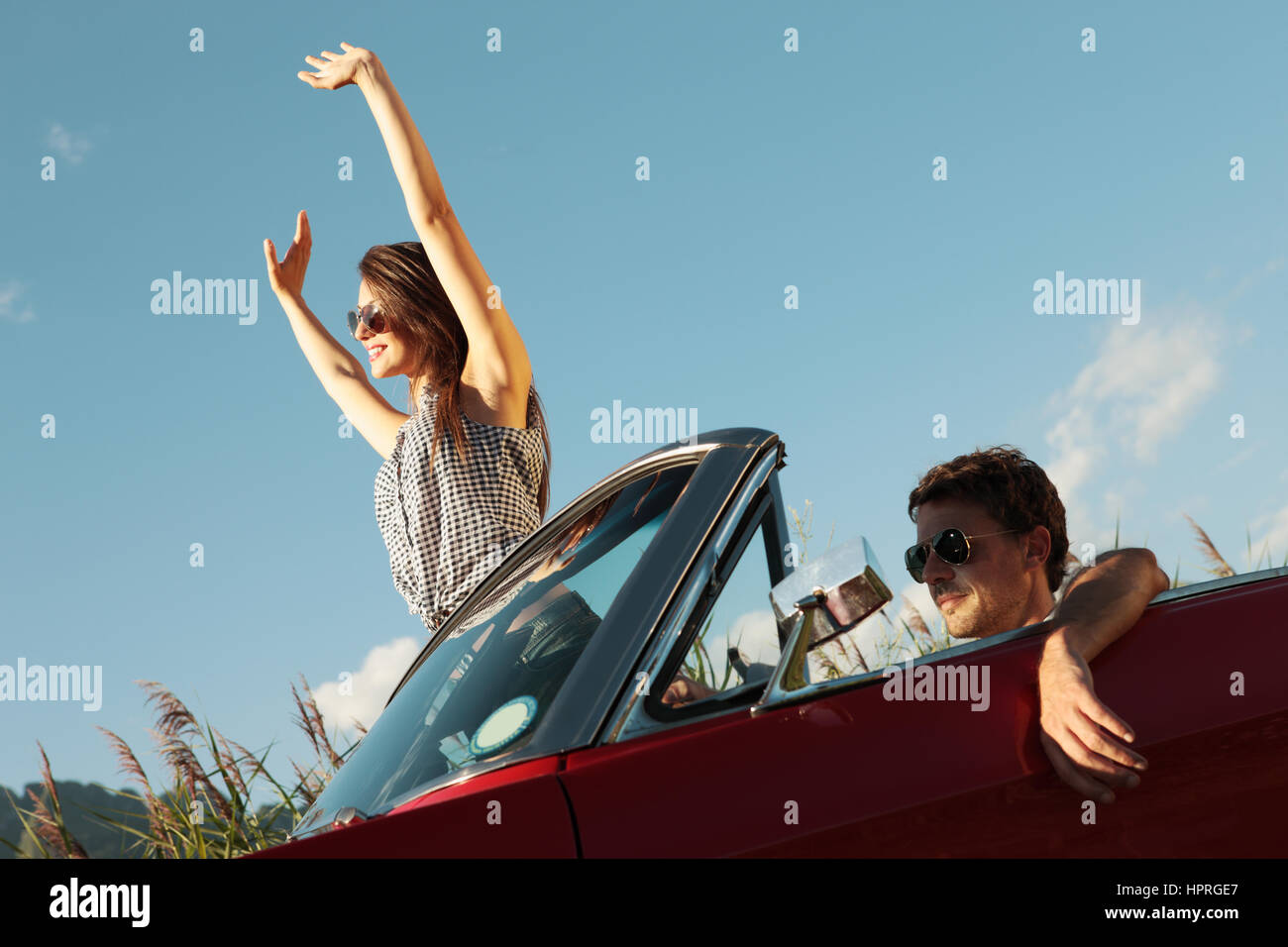 Happy young people in a convertible car Stock Photo