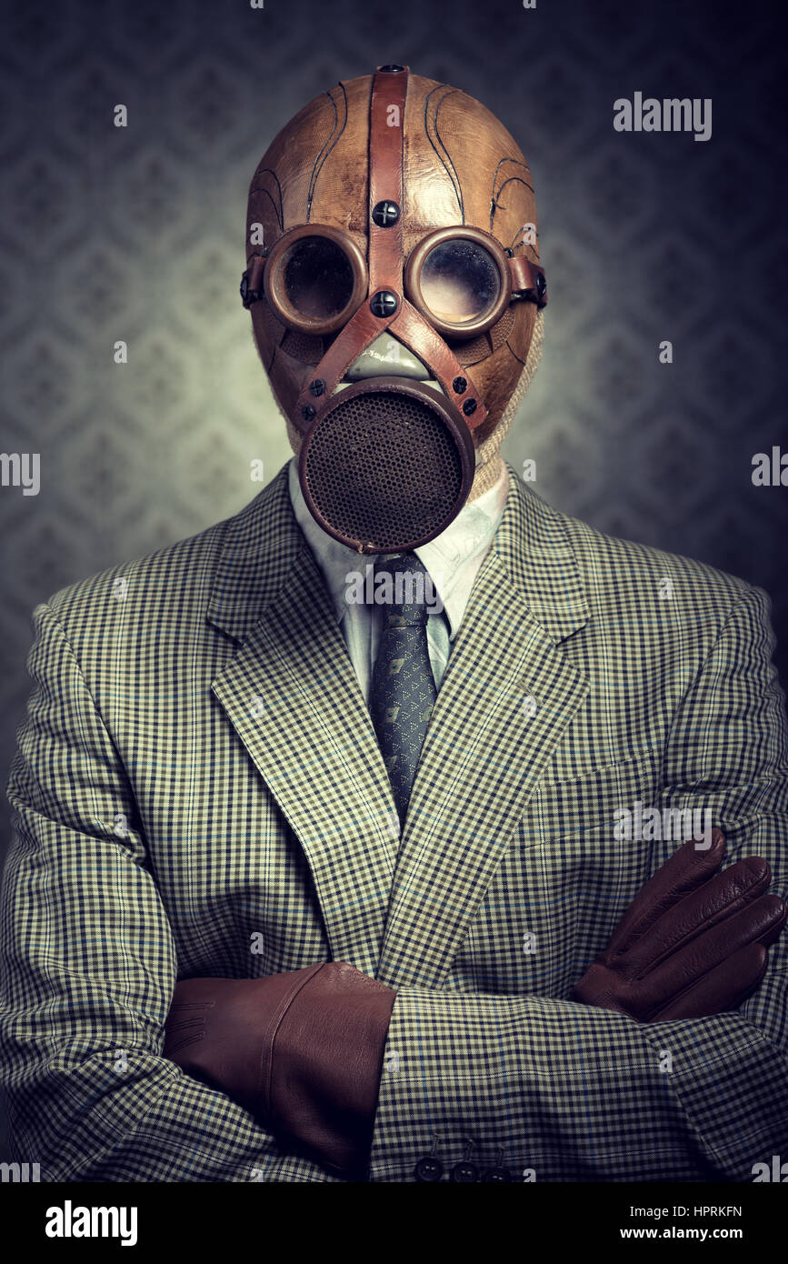 Vintage Businessman Wearing A Gas Mask With Retro Wallpaper On Background