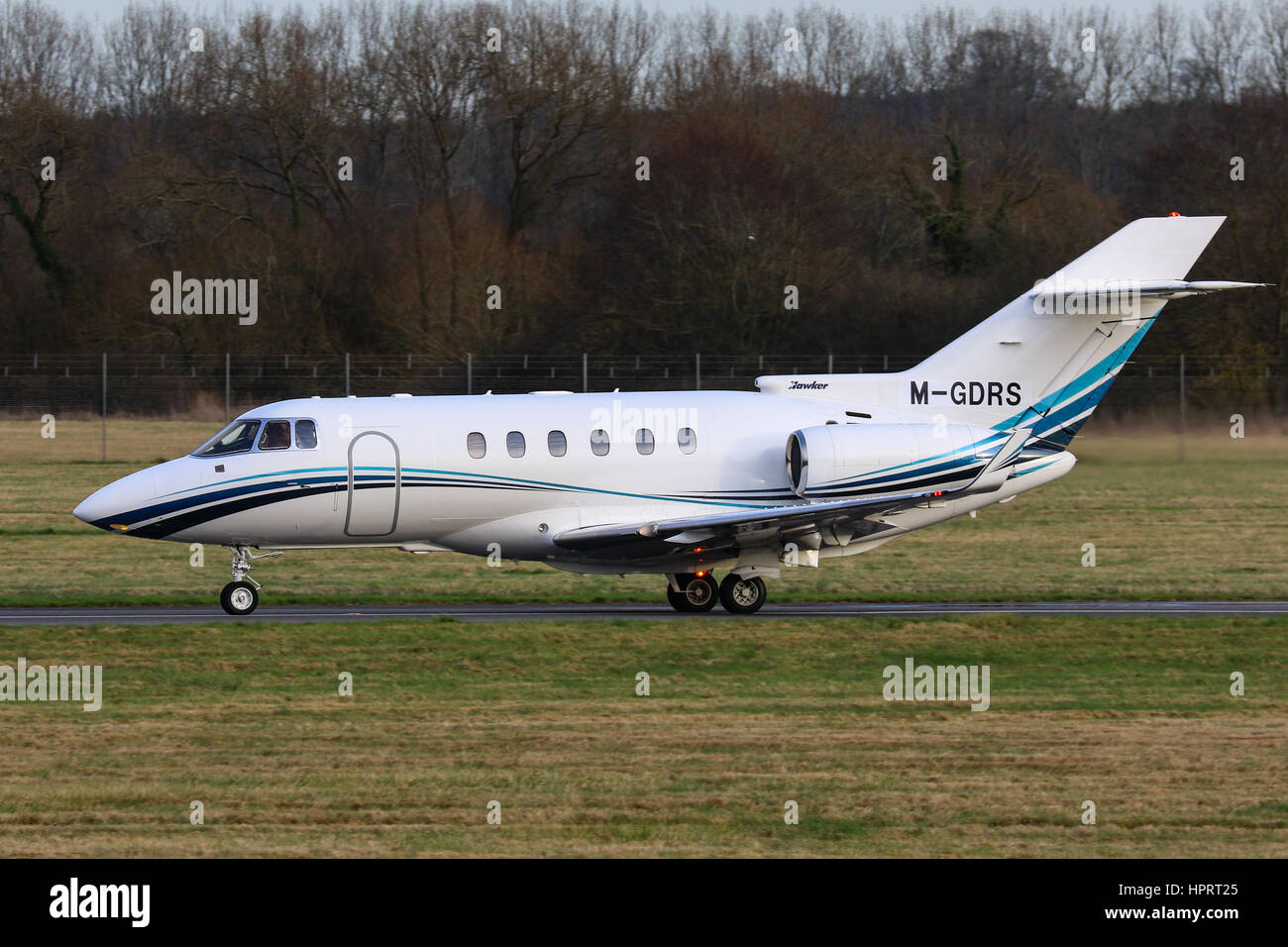Hawker Beechcraft 800XP M-GDRS taxiing for take-off at Southampton Airport - Stock Image
