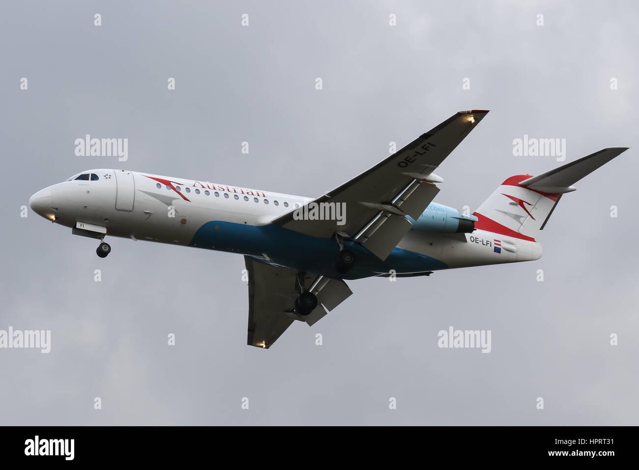 Austrian Airlines Fokker 70 OE-LFI landing at Southampton Airport - Stock Image