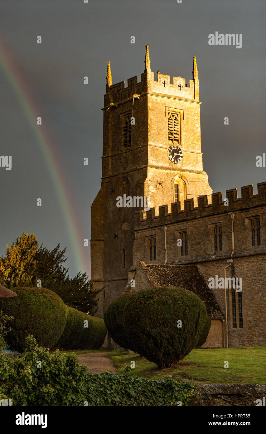 Rainbow on a stormy day at the church of St Peter and St Paul at Long Compton, Warwickshire, England, UK. - Stock Image