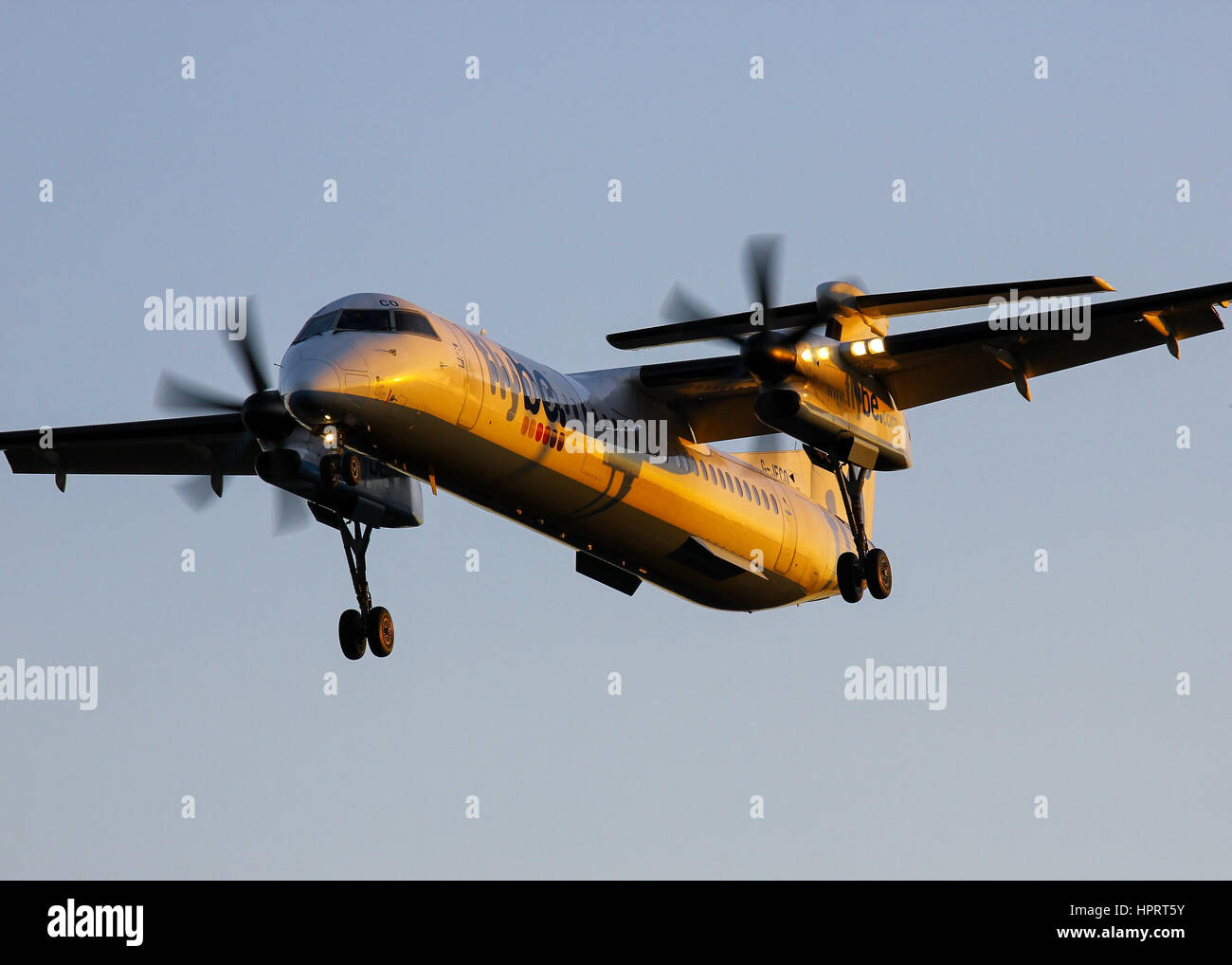 Flybe Bombardier Dash-8 Q400 G-JECO landing at Southampton Airport - Stock Image