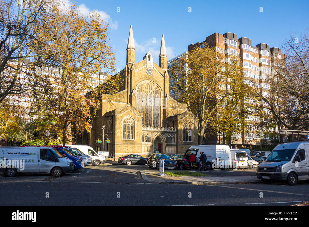 Cars and vans parked outside St John's, Hyde Park,  Hyde Park Crescent, London, UK - Stock Image
