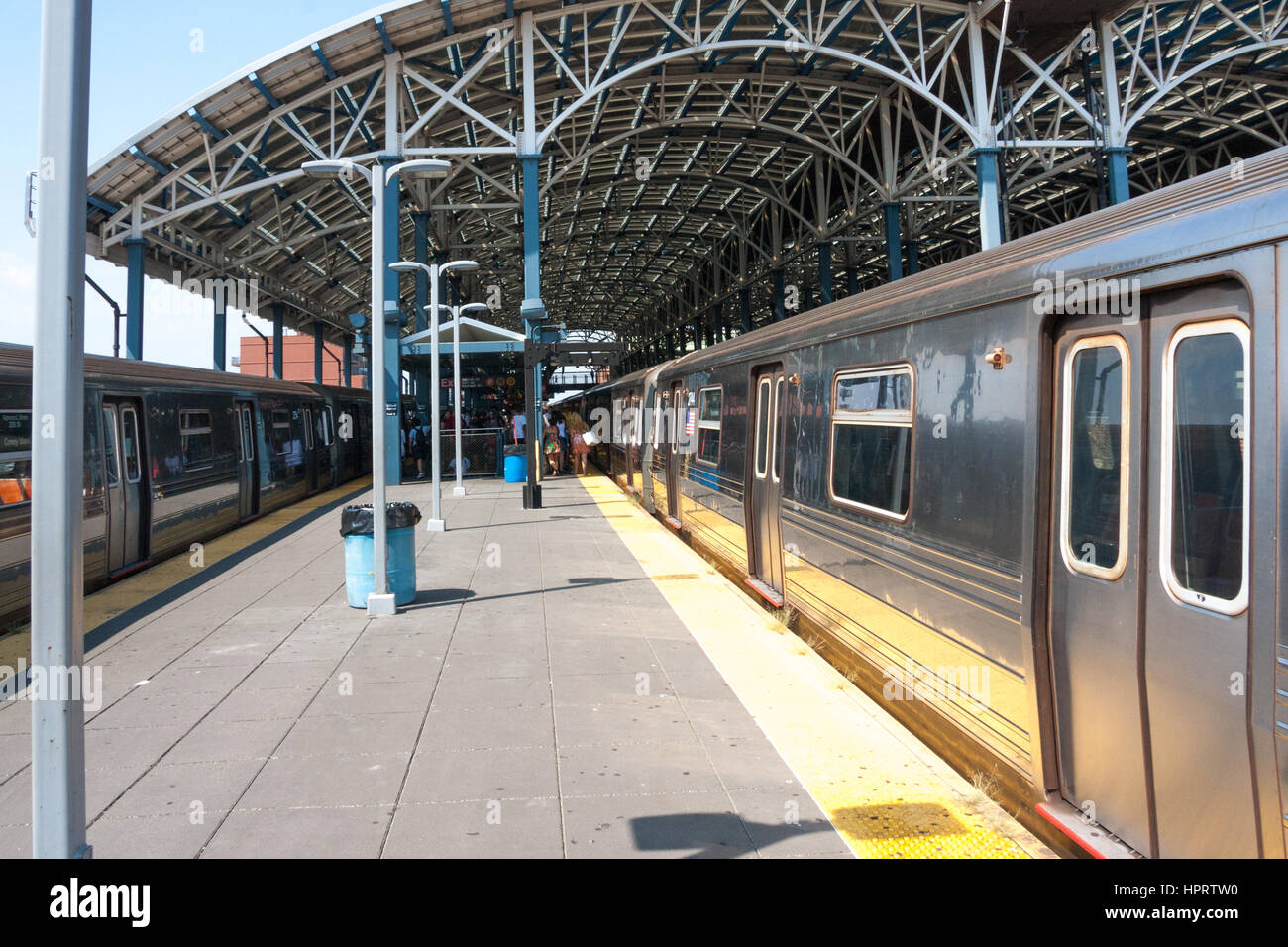 Q line train and platform on Coney Island subway station, Brooklyn, New York - Stock Image