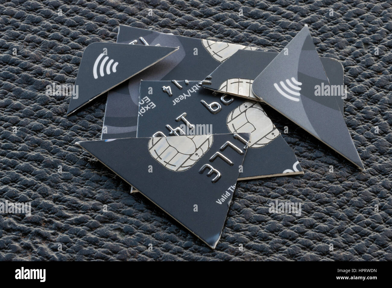 At expiry of bank cards, it is advised to cut them into pieces to destroy them. Cut up credit card through embedded - Stock Image