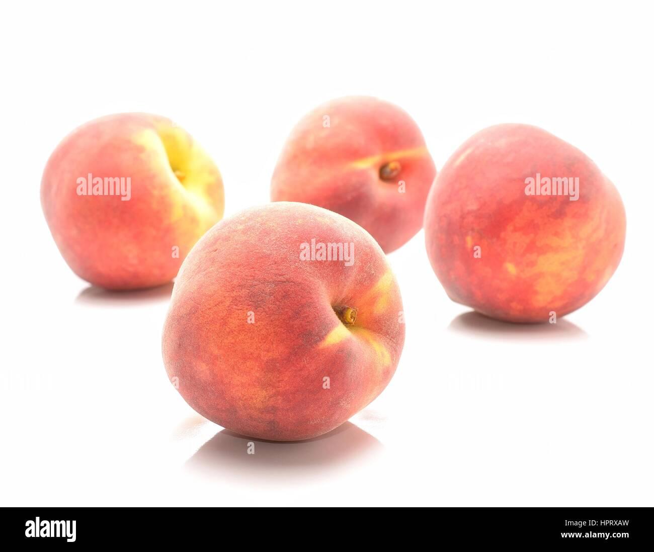 Ripe peach fruit isolated on white background - Stock Image