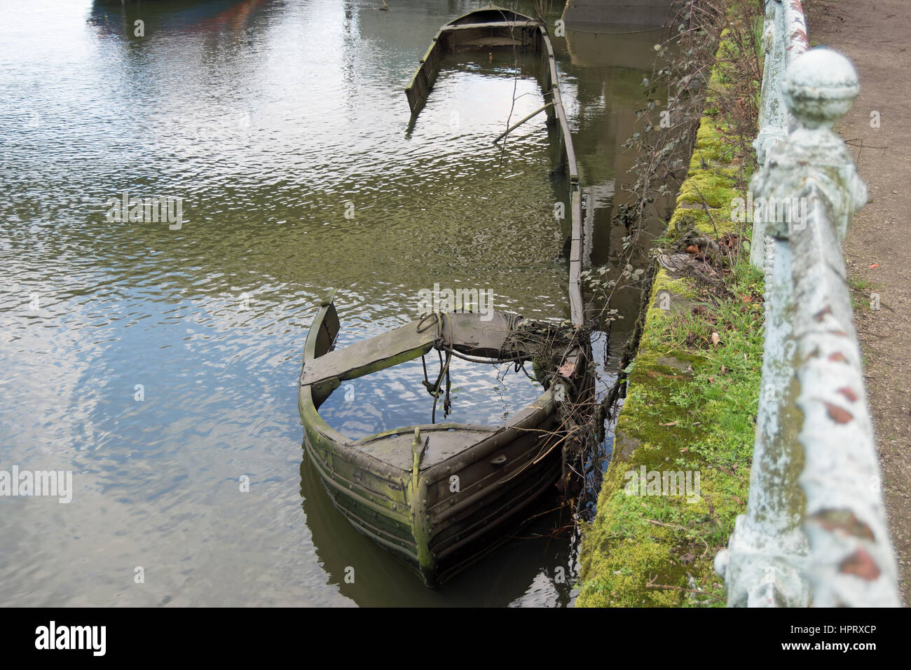 partially submerged boat on the river thames near richmond bridge, southwest london, england - Stock Image