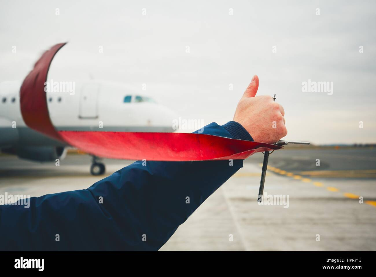 Member of ground crew is showing OK sign to pilot before take off. - Stock Image