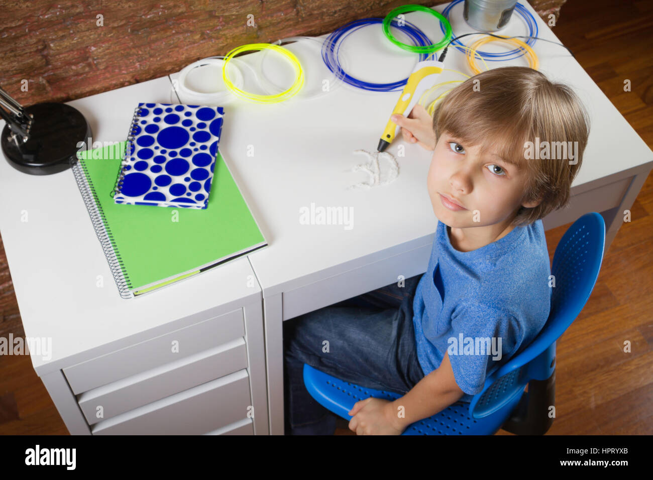 Child drawing with 3D printing pen. Boy making new item. Creative, technology, leisure, education concept - Stock Image