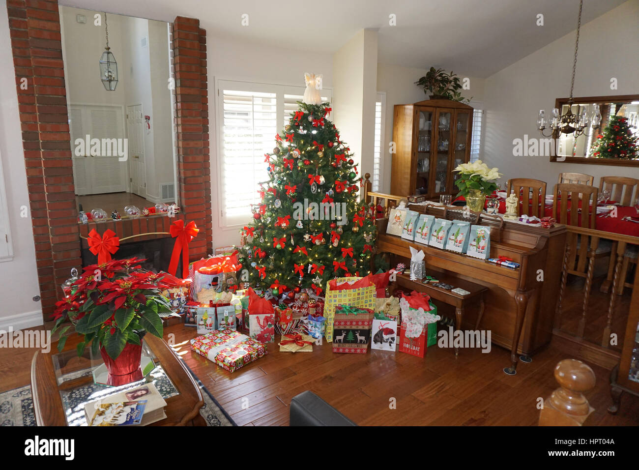 Christmas Tree with Red Ribbons - Stock Image