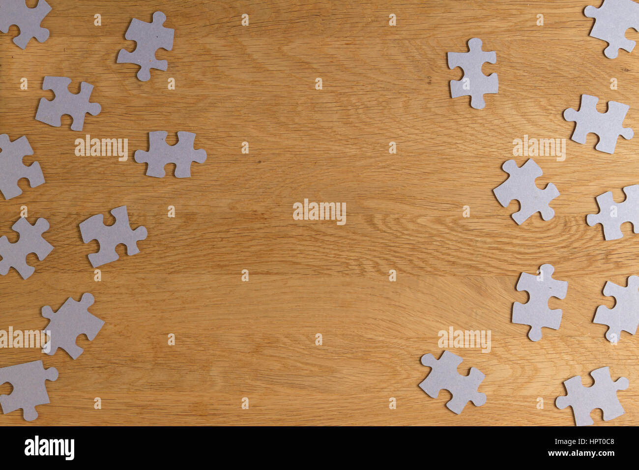 Puzzle Game Paper Pieces Pattern Frame On Wooden Background Top