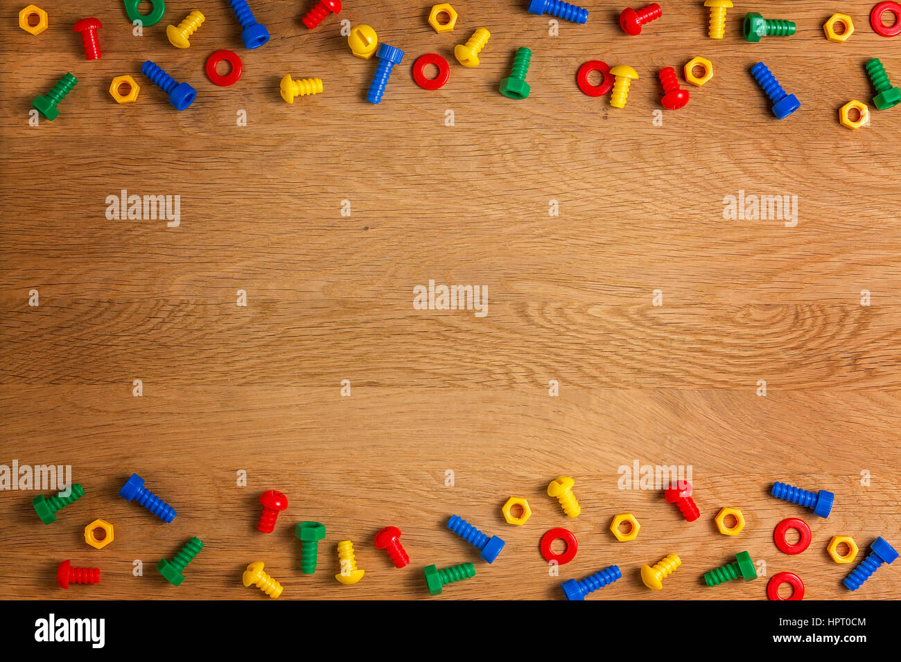 Kids Toys Tools Colorful Screws And Nuts On Wooden Background Top