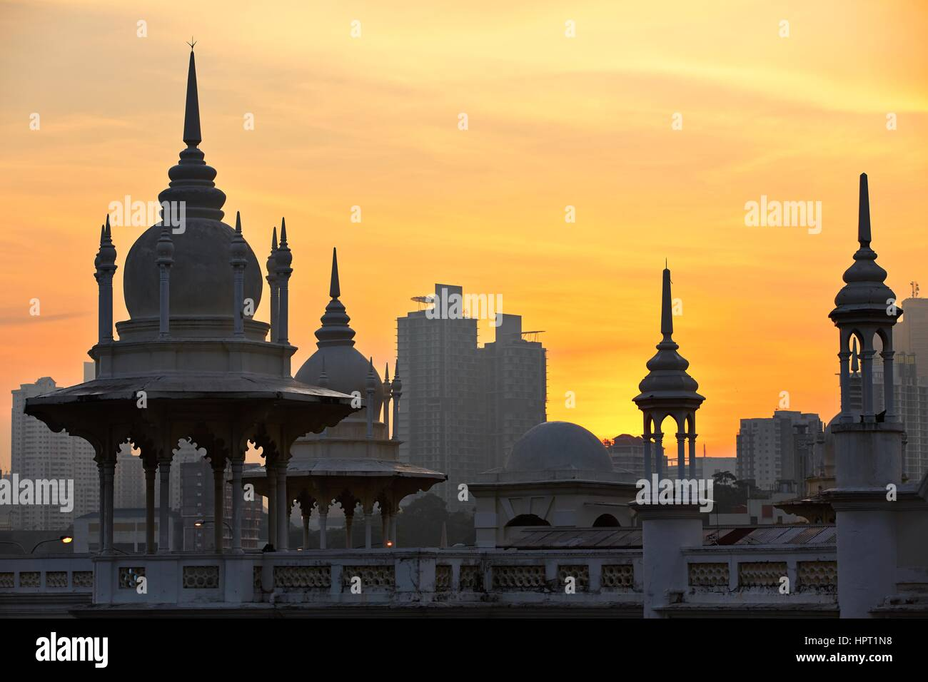 Towers of the historical building railway station in Kuala Lumpur at sunrise. Stock Photo