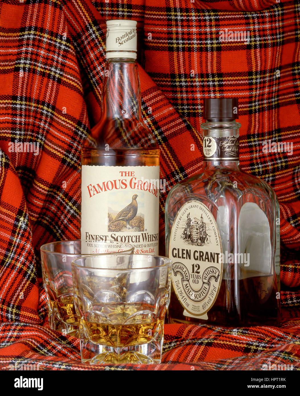 Bottles of Scottish whisky with glasses, Inverness, Scottish Highlands, Scotland, United Kingdom - Stock Image