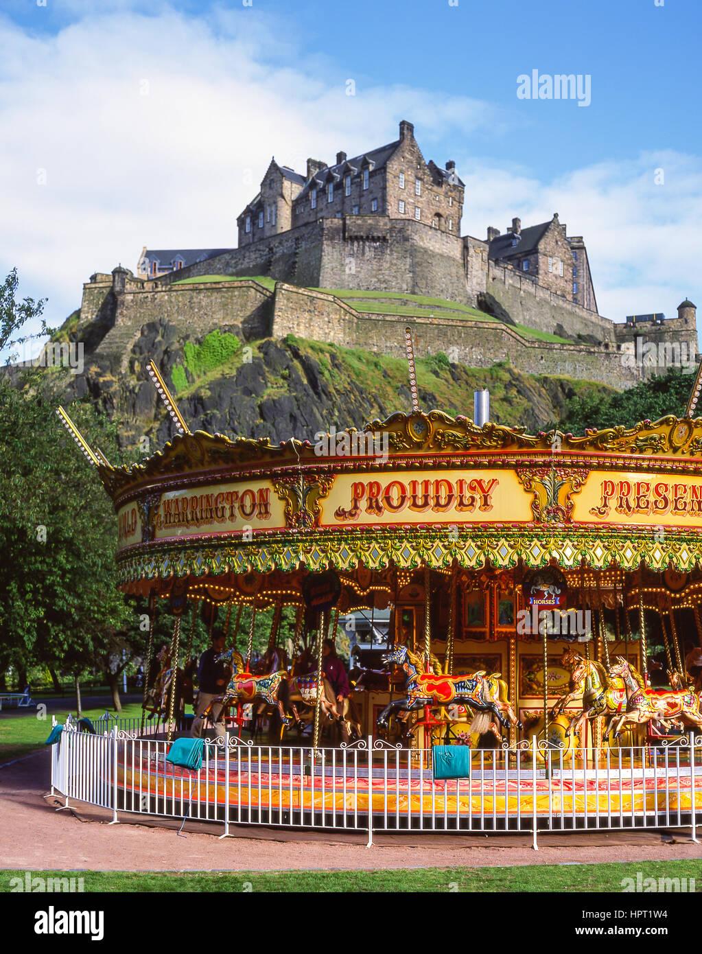Children's carousel beneath Edinburgh Castle, Princes Street Gardens, Edinburgh, Lothian, Scotland, United Kingdom - Stock Image