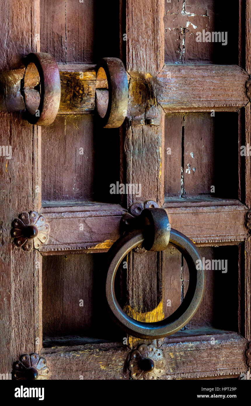 Rajasthan, India - Nov. 21, 2016: Close view of an antique traditional wooden door at Kumbhal Garh palace with a - Stock Image