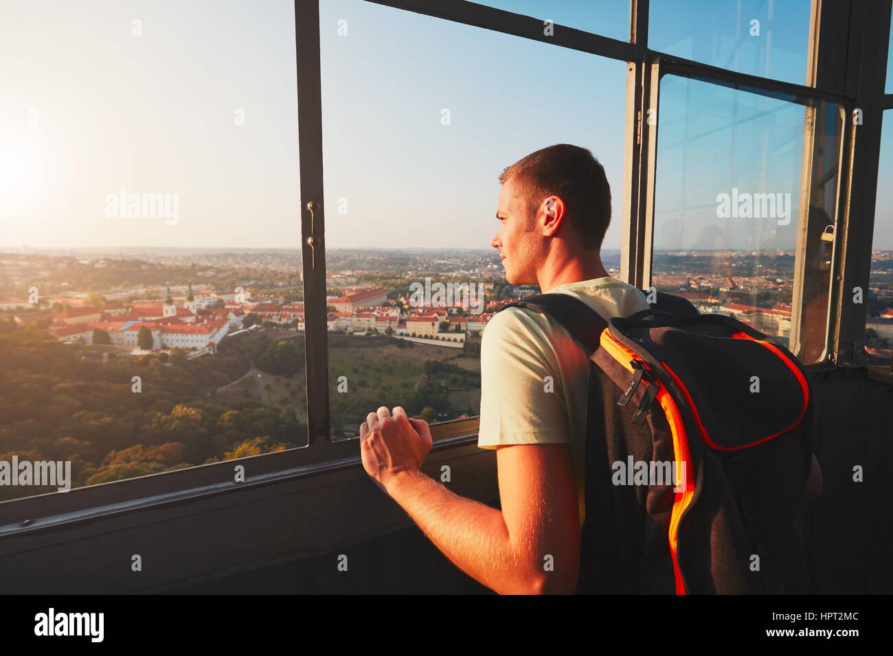 Young tourist looking on the historical part of Prague Capital. Strahov Monastery and park under Petrin hill at Stock Photo