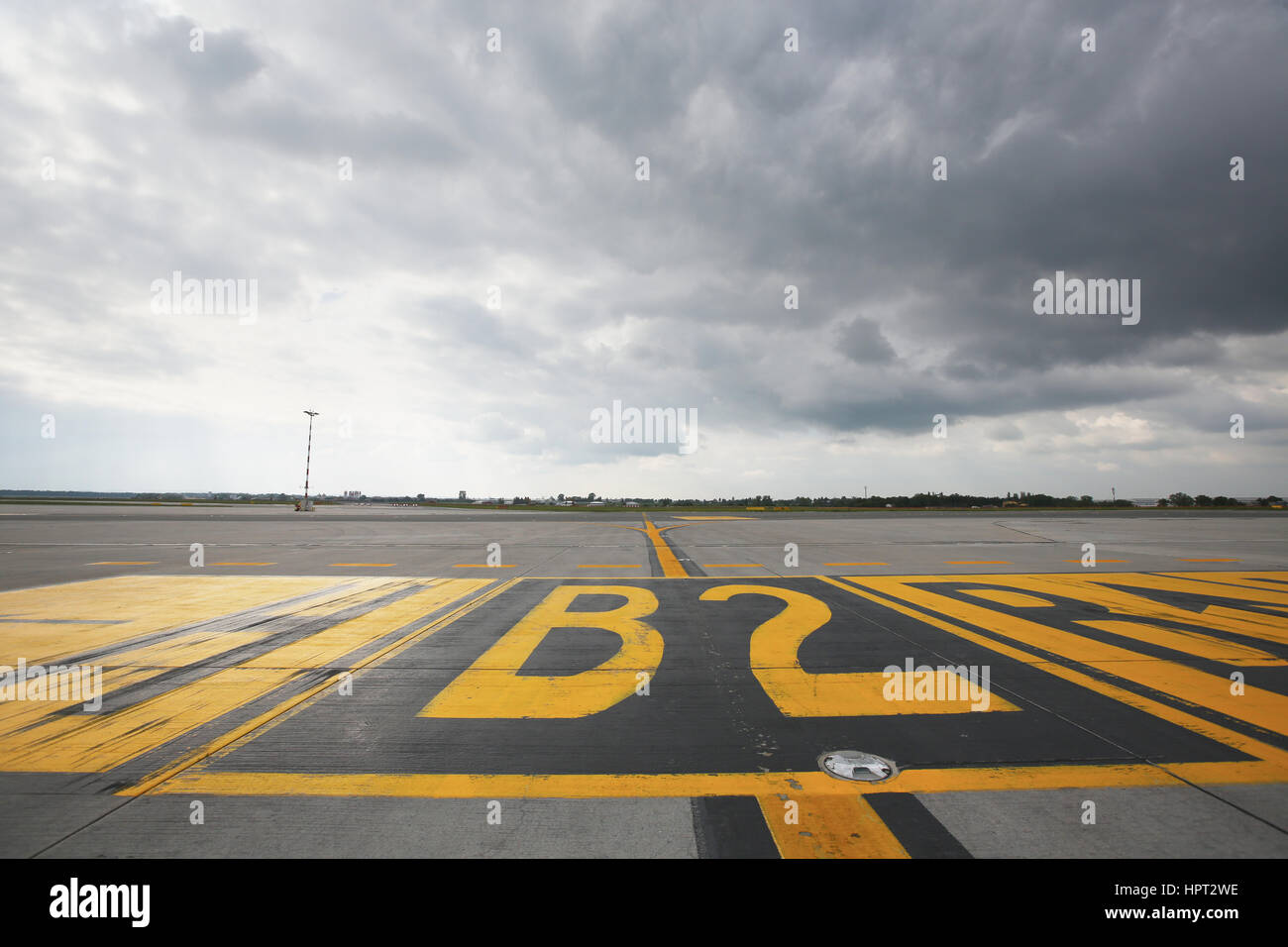 Airfield - marking on taxiway is heading to runway. - Stock Image