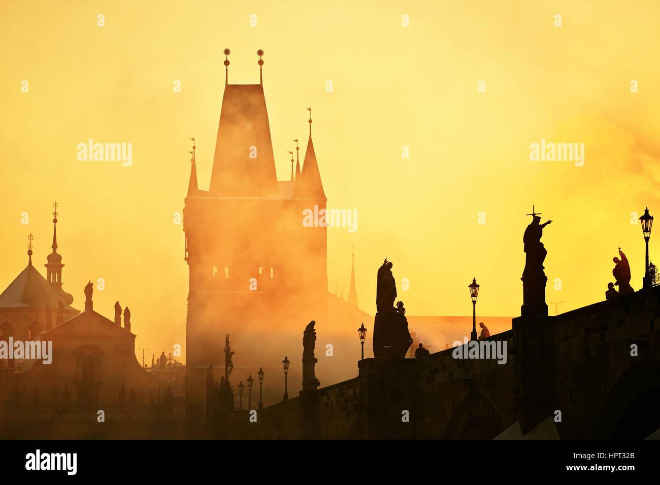 Mystery fog in sunrise. Charles bridge in Prague, Czech Republic. - Stock Image