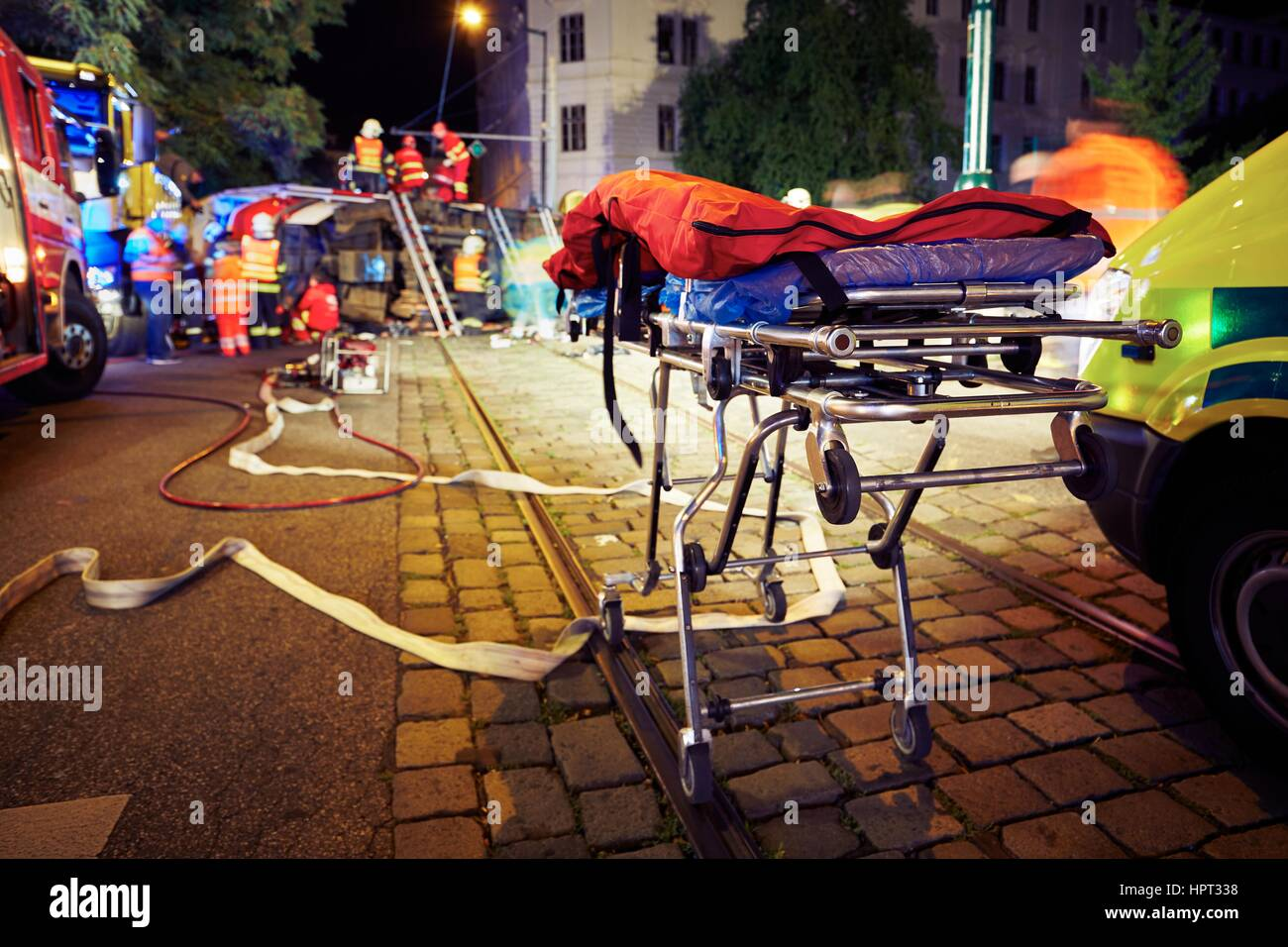 Accident on the city road at night. - Stock Image