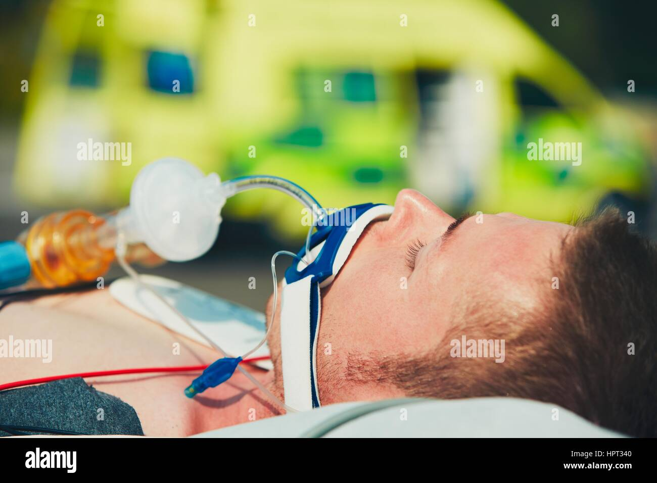 Paramedic preparing the patient after resuscitation for transport to the hospital. - Stock Image