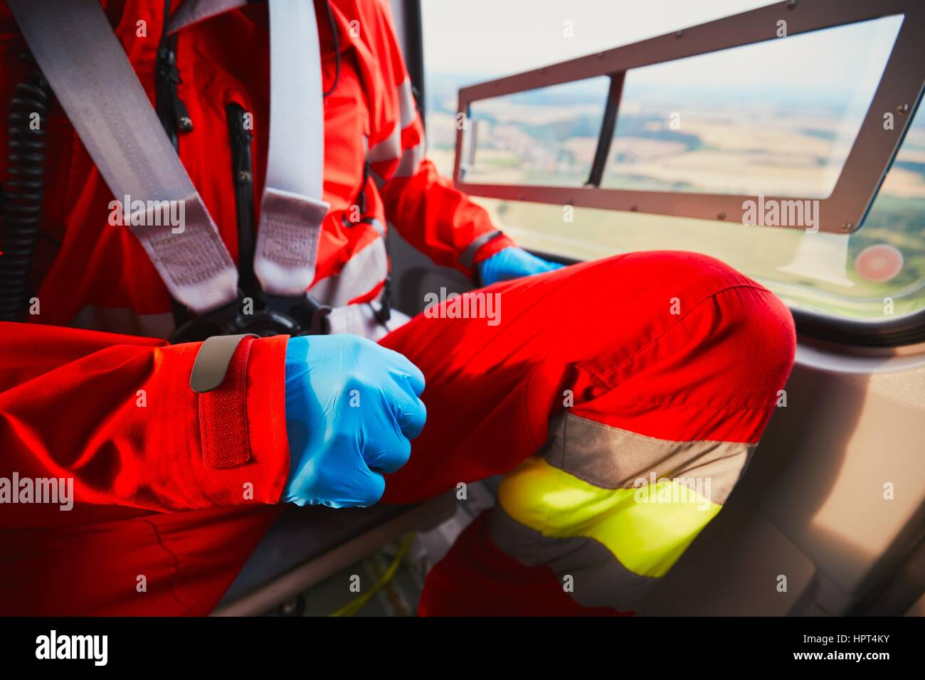 Alarm for the air rescue service. Doctor is preparing in the helicopter emergency medical service. - selective focus - Stock Image