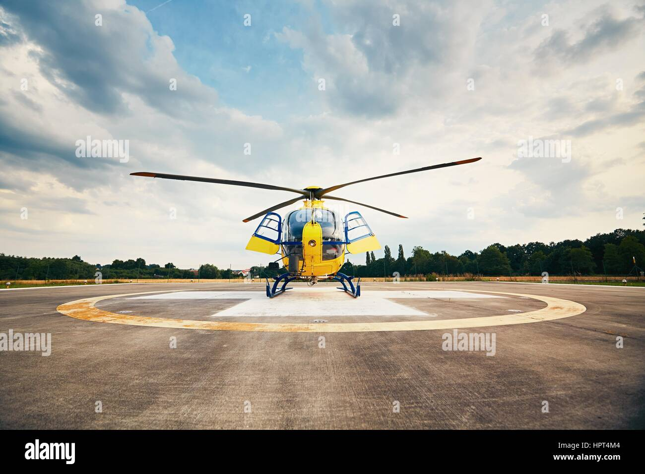 Air rescue service. Helicopter air ambulance is ready for take off at the heliport. - Stock Image