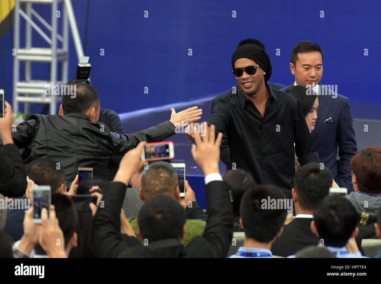 Haikou, China's Hainan Province. 24th Feb, 2017. Club Ambassador of Futbol Club Barcelona (FCB) Ronaldinho greets - Stock Image