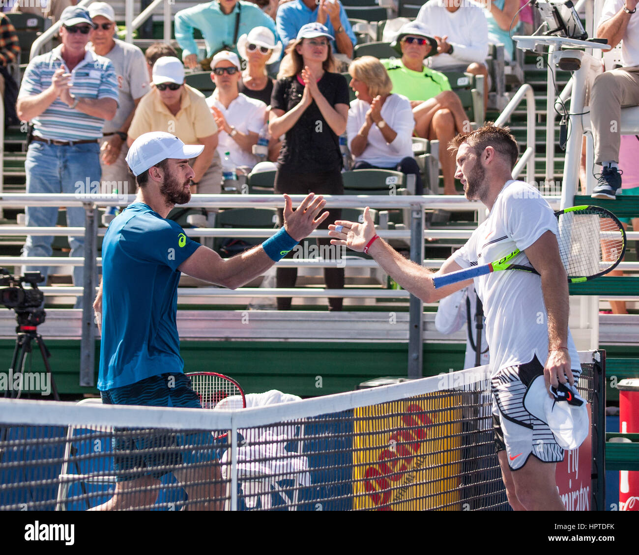 Delray Beach, Palm Beach County, US. 24th Feb, 2017. Fifth-seeded American tennis pro STEVE JOHNSON (left) shakes - Stock Image