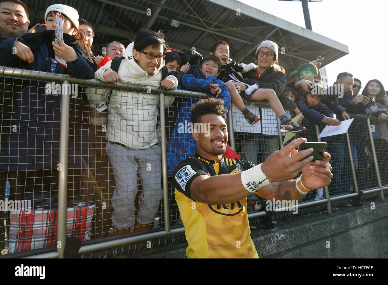 Ardie Savea of the Hurricanes takes a selfie with fans during the HITO-Communications Sunwolves vs Hurricanes in - Stock Image