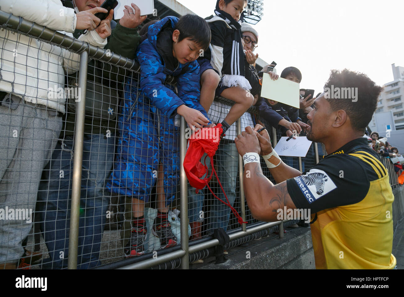 Ardie Savea of the Hurricanes signs autographs for fans during the HITO-Communications Sunwolves vs Hurricanes in - Stock Image