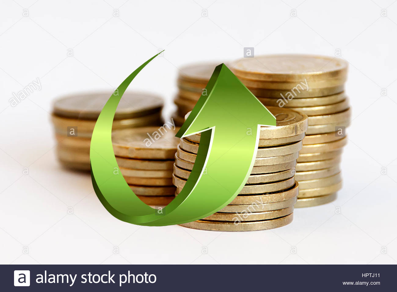 Stacks of coins with a green arrow up on them - Stock Image
