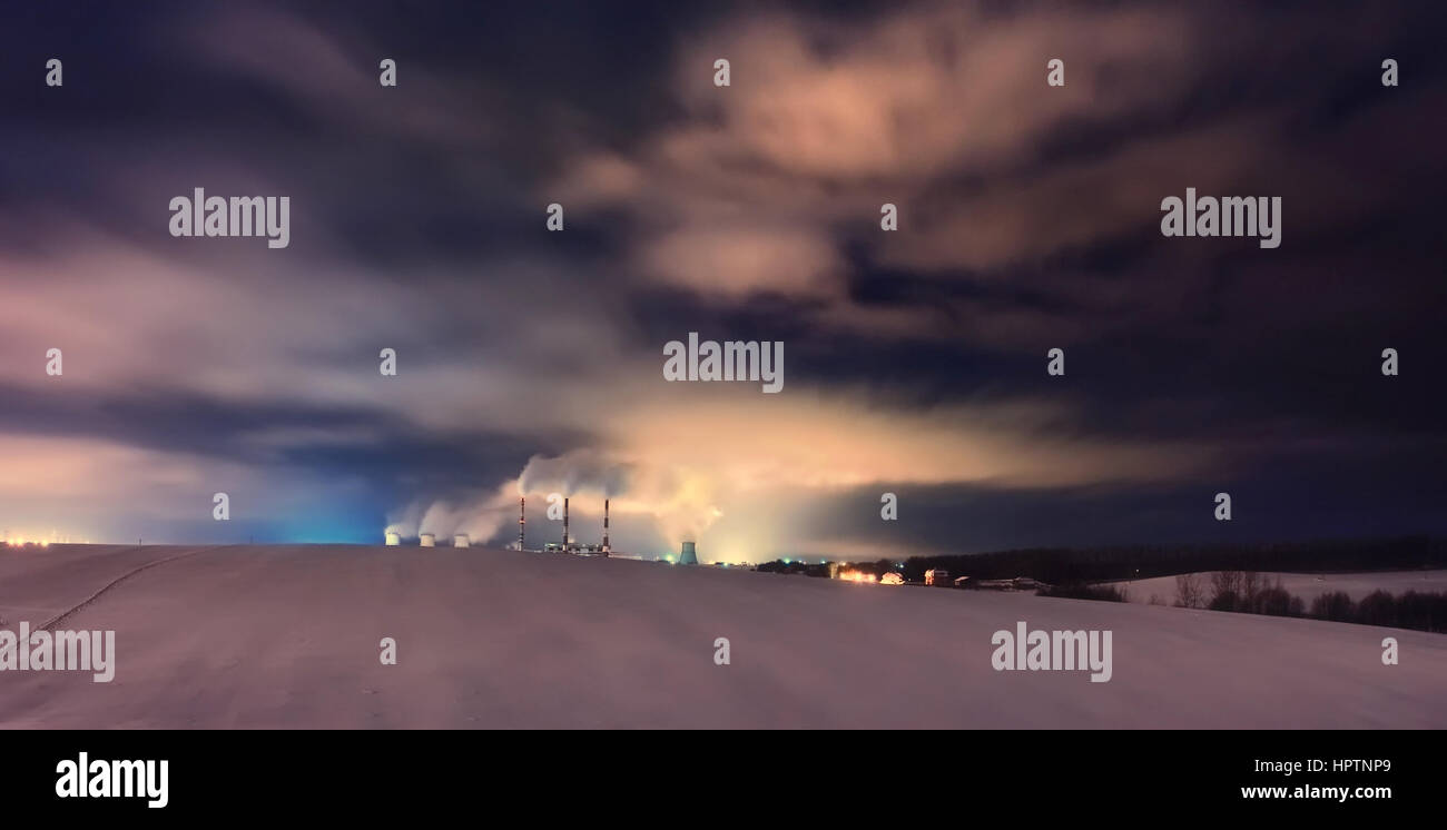 Nuclear power plant at night with smooth cloudy sky - Stock Image