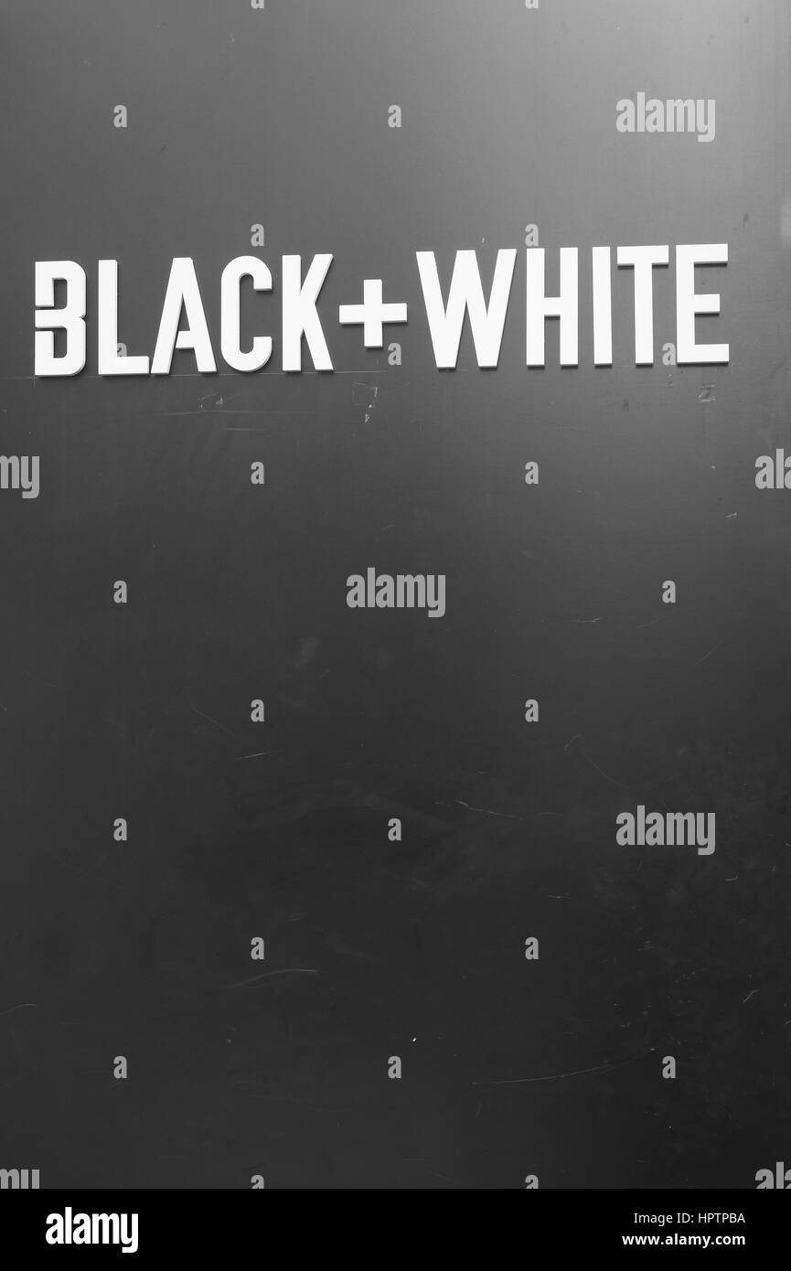 BLACK+WHITE writing on a wall - Stock Image