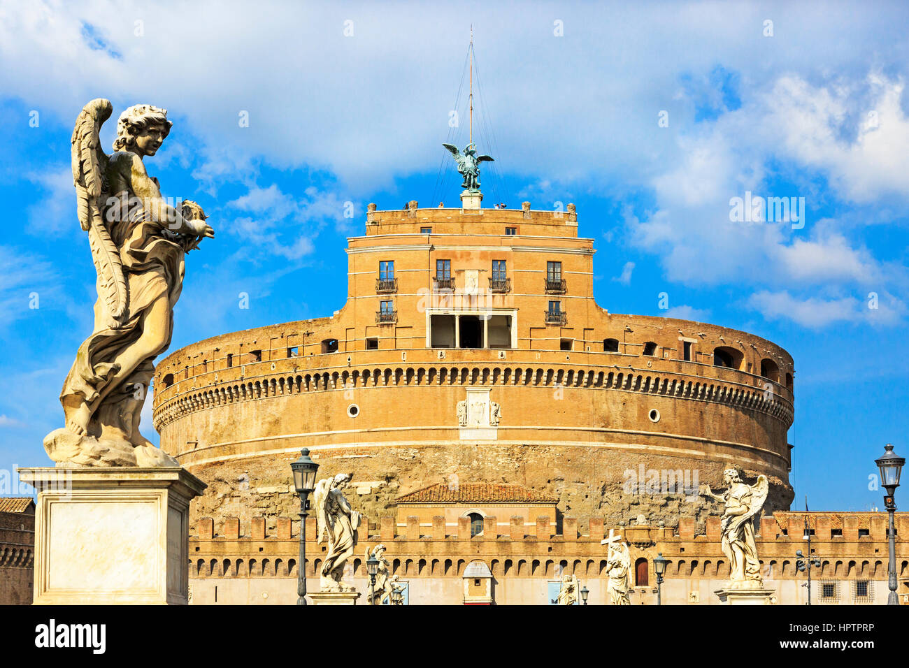 Angels on the bridge Ponte Sant Angelo framing the Castle Sant Angelo, in parco Adriano district, Rome, Italy - Stock Image