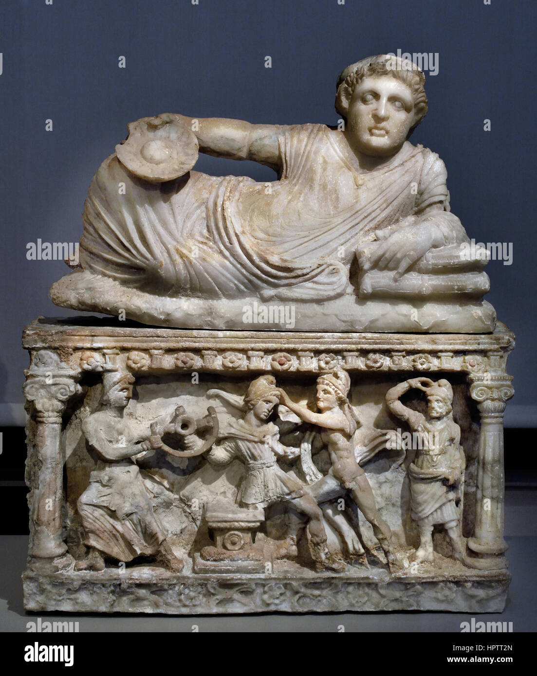 Cinerary Urn with Lid: Reclining Deceased with Kantharos; Perugia (Italy), 150 BC Italy  ( The front of the urn Stock Photo
